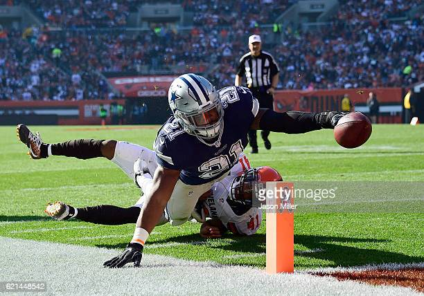 Ezekiel Elliott of the Dallas Cowboys dives for a 10 yard touchdown in the first half against the Cleveland Browns at FirstEnergy Stadium on November...