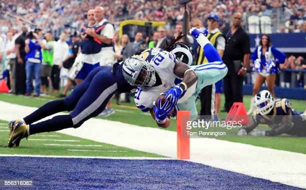 Ezekiel Elliott of the Dallas Cowboys dives into the end zone to score a touchdown against Mark Barron of the Los Angeles Rams in the second quarter...