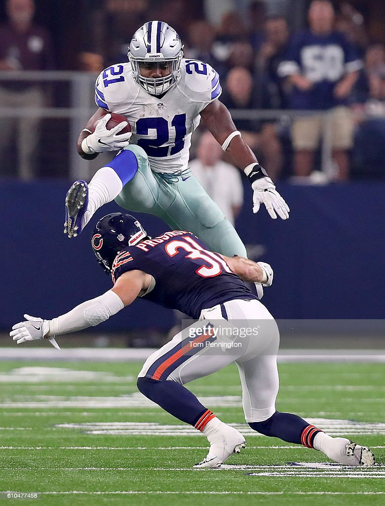 Ezekiel Elliott #21 of the Dallas Cowboys hurdles Chris Prosinski #31 of the Chicago Bears while carrying the ball in the fourth quarter at AT&T Stadium on September 25, 2016 in Arlington, Texas.