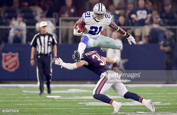 Ezekiel Elliott of the Dallas Cowboys hurdles Chris Prosinski of the Chicago Bears while carrying the ball in the fourth quarter at ATT Stadium on...