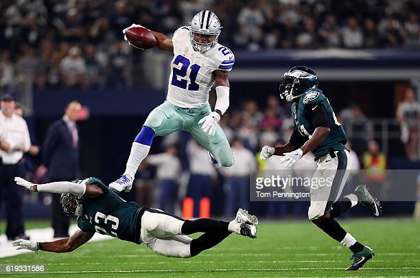 Ezekiel Elliott of the Dallas Cowboys runs the ball against Rodney McLeod of the Philadelphia Eagles in the second quarter during a game between the...