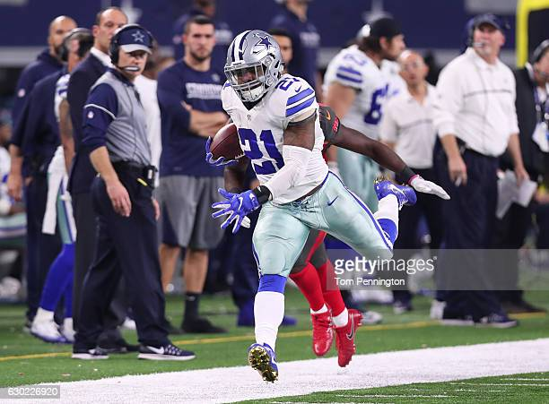 Ezekiel Elliott of the Dallas Cowboys rushes the ball during the fourth quarter against the Tampa Bay Buccaneers at ATT Stadium on December 18 2016...