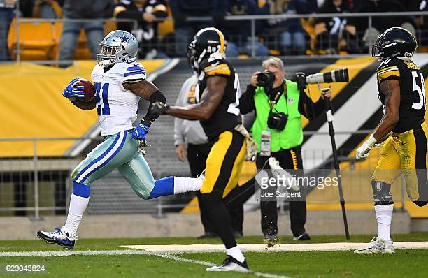 Ezekiel Elliott of the Dallas Cowboys rushes towards the end zone past William Gay of the Pittsburgh Steelers for an 83 yard touchdown reception in...