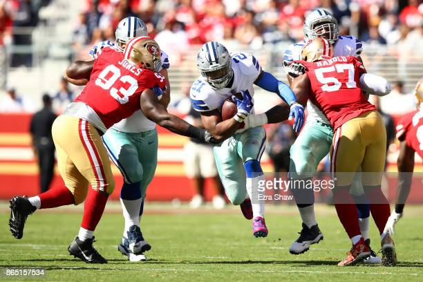 Ezekiel Elliott of the Dallas Cowboys rushes with the ball against the San Francisco 49ers during their NFL game at Levi's Stadium on October 22 2017...