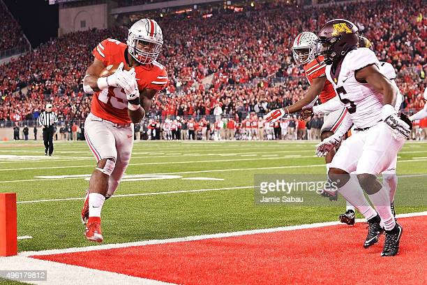 Ezekiel Elliott of the Ohio State Buckeyes scores on a 15yard touchdown run in the second quarter against the Minnesota Golden Gophers at Ohio...