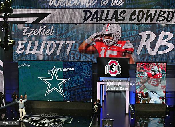 Ezekiel Elliott walks on the stage after being drafted by the Dallas Cowboys during the 2016 NFL Draft at the Auditorium Theater on April 28 2016 in...
