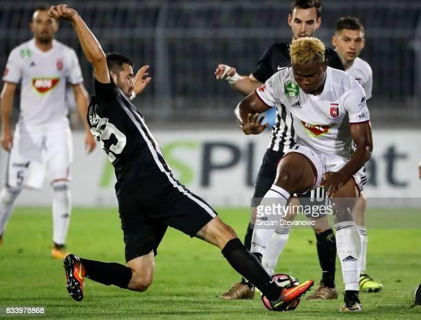 Ezekiel Henty of Videoton in action against Milan Radin of Partizan during the UEFA Europa League Qualifying PlayOffs round first leg match between...