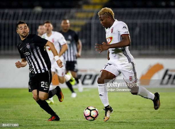 Ezekiel Henty of Videoton in action against Milan Radin of Partizan in action during the UEFA Europa League Qualifying PlayOffs round first leg match...