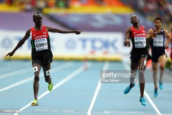 Ezekiel Kemboi of Kenya crosses the line to win gold ahead of Conseslus Kipruto of Kenya in the Men's 3000 metres steeplechase final during Day Six...