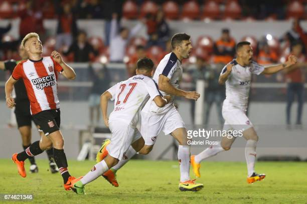Ezequiel Barco of Independiente celebrates with teammates after scoring the second goal of his team during a match between Independiente and...