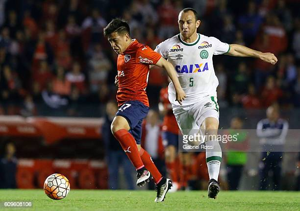 Ezequiel Barco of Independiente fights for the ball with Josimar of Chapecoense during a first leg match between Independiente and Chapecoense as...