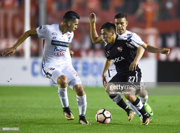 Ezequiel Barco of Independiente fights for the ball with Juan Vieyra of Nacional during a second leg match between Independiente and Nacional as part...