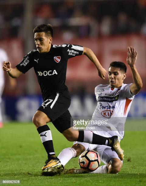 Ezequiel Barco of Independiente fights for the ball with Walter Rodriguez of Nacional during a second leg match between Independiente and Nacional as...