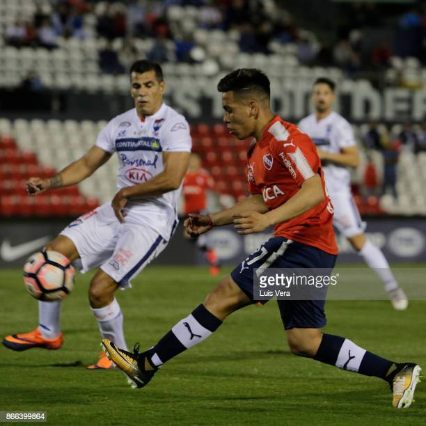 Ezequiel Barco of Independiente kicks the ball during a first leg match between Nacional and Independiente as part of the quarter finals of Copa...