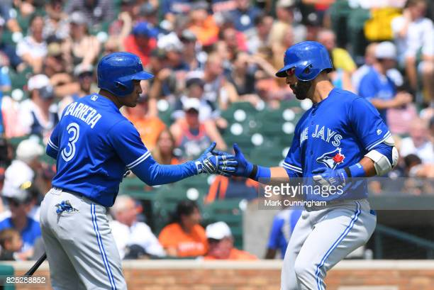 Ezequiel Carrera and Jose Bautista of the Toronto Blue Jays shake hands during the game against the Detroit Tigers at Comerica Park on July 16 2017...
