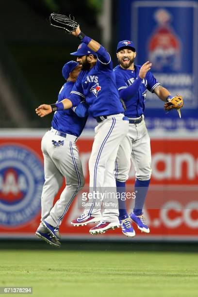 Ezequiel Carrera Jose Bautista and Kevin Pillar of the Toronto Blue Jays celebrate defeating the Los Angeles Angels of Anaheim 87 in a thirteen...