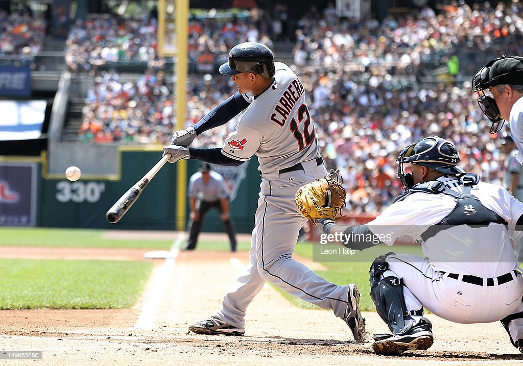 <a gi-track='captionPersonalityLinkClicked' href=/galleries/search?phrase=Ezequiel+Carrera&family=editorial&specificpeople=6778888 ng-click='$event.stopPropagation()'>Ezequiel Carrera</a> #12 of the Cleveland Indians doubles to deep left field during the first inning of the game against the Detroit Tigers at Comerica Park on August 5, 2012 in Detroit, Michigan.