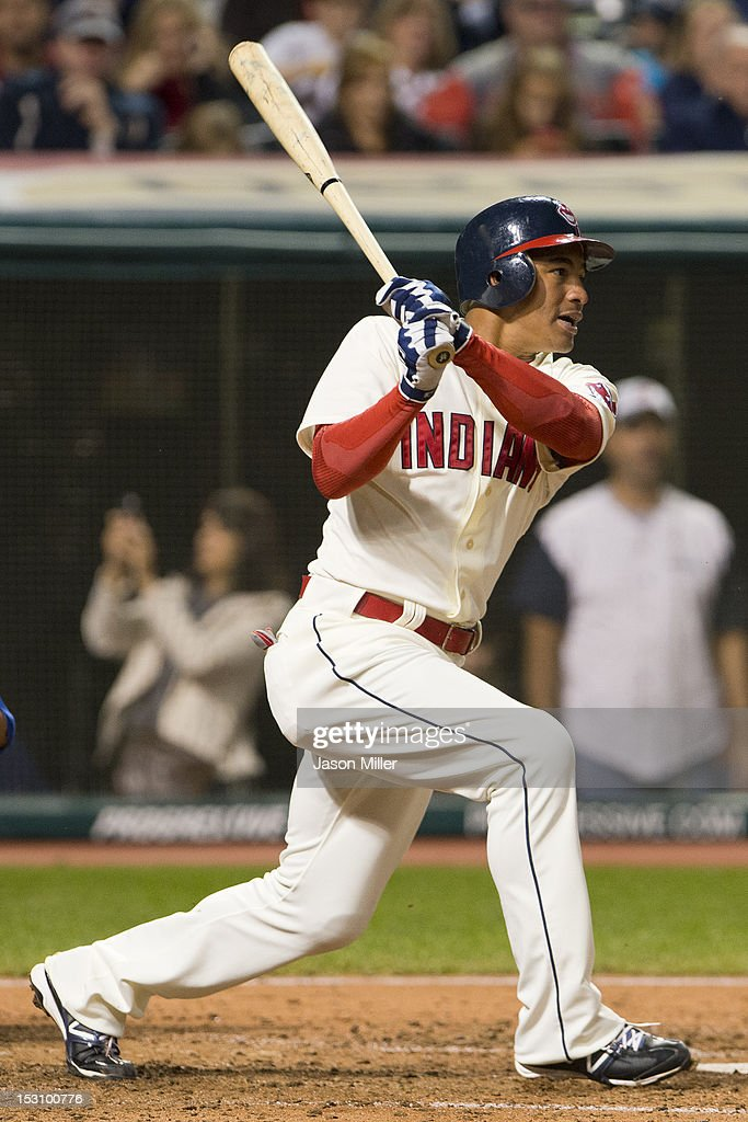 <a gi-track='captionPersonalityLinkClicked' href=/galleries/search?phrase=Ezequiel+Carrera&family=editorial&specificpeople=6778888 ng-click='$event.stopPropagation()'>Ezequiel Carrera</a> #12 of the Cleveland Indians hits a ground ball to the pitcher and reaches on an error during the sixth inning against the Kansas City Royals at Progressive Field on September 29, 2012 in Cleveland, Ohio.