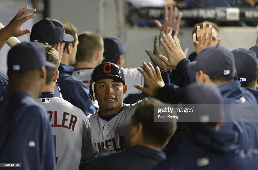 <a gi-track='captionPersonalityLinkClicked' href=/galleries/search?phrase=Ezequiel+Carrera&family=editorial&specificpeople=6778888 ng-click='$event.stopPropagation()'>Ezequiel Carrera</a> #12 of the Cleveland Indians is greeted in the dugout after scoring on an RBI single hit by teammate Jason Kipnis #22 during the fourth inning at U.S. Cellular Field on September 26, 2012 in Chicago, Illinois. Lonnie Chisenhall #8 of the Cleveland Indians also scored on the hit.