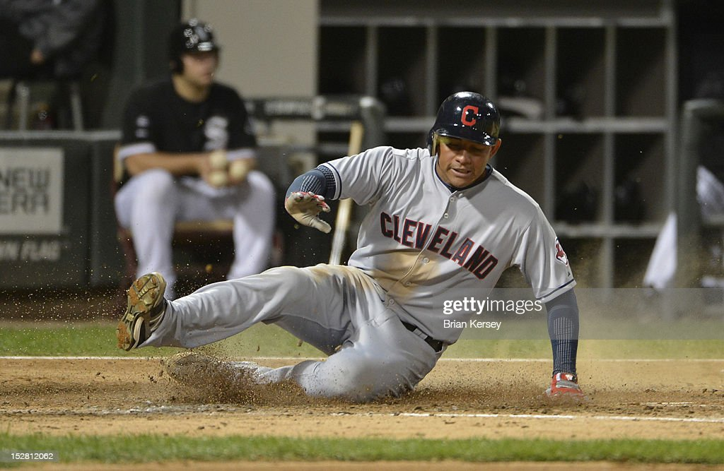 <a gi-track='captionPersonalityLinkClicked' href=/galleries/search?phrase=Ezequiel+Carrera&family=editorial&specificpeople=6778888 ng-click='$event.stopPropagation()'>Ezequiel Carrera</a> #12 of the Cleveland Indians scores on an RBI single hit by teammate Jason Kipnis #22 during the fourth inning at U.S. Cellular Field on September 26, 2012 in Chicago, Illinois. Lonnie Chisenhall #8 of the Cleveland Indians also scored on the hit.