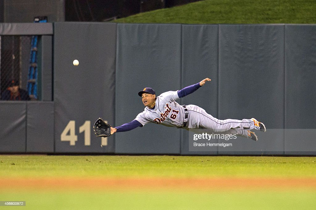 Ezequiel Carrera of the Detroit Tigers fields and attempts a diving catch against the Minnesota Twins on September 16 2014 at Target Field in...