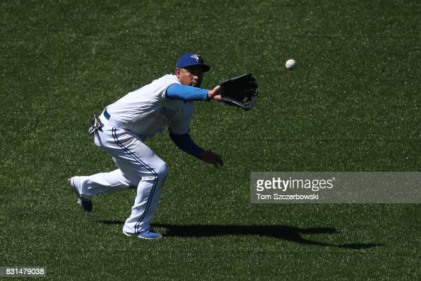 Ezequiel Carrera of the Toronto Blue Jays catches a line drive out in the seventh inning during MLB game action against the Pittsburgh Pirates at...