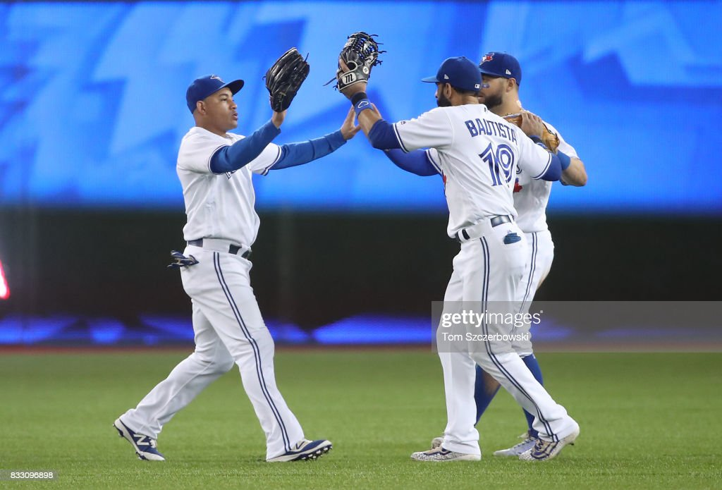 Ezequiel Carrera #3 of the Toronto Blue Jays celebrates a victory with Jose Bautista #19 and Kevin Pillar #11 during MLB game action against the Tampa Bay Rays at Rogers Centre on August 16, 2017 in Toronto, Canada.
