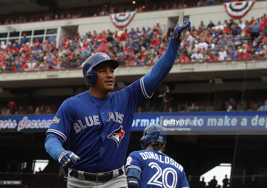 Ezequiel Carrera of the Toronto Blue Jays celebrates after hitting a solo home run against the Texas Rangers in the fifth inning of game two of the...