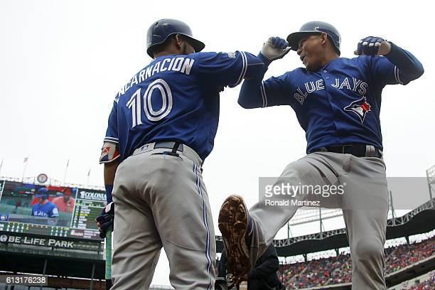 Ezequiel Carrera of the Toronto Blue Jays celebrates with Edwin Encarnacion after hitting a solo home run against the Texas Rangers in the fifth...