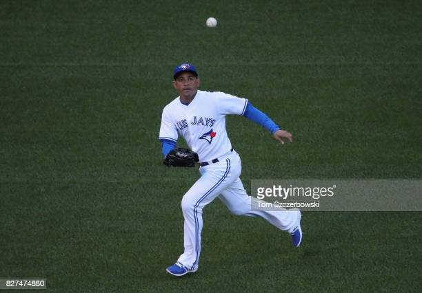 Ezequiel Carrera of the Toronto Blue Jays goes after a highhop single to left field in the first inning during MLB game action against the Oakland...