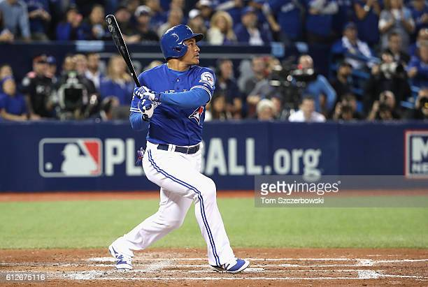 Ezequiel Carrera of the Toronto Blue Jays hits an RBI single in the fifth inning against the Baltimore Orioles during the American League Wild Card...