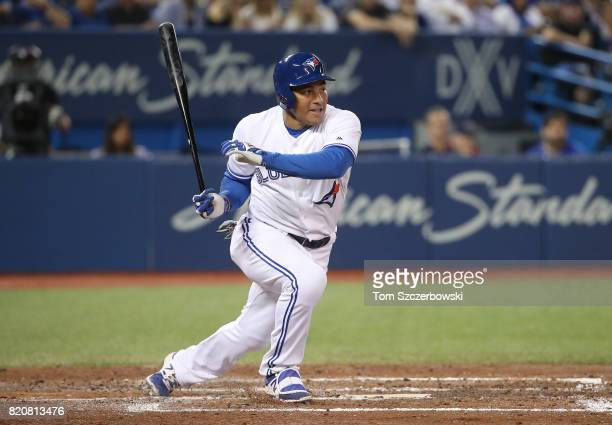 Ezequiel Carrera of the Toronto Blue Jays hits into a fielder's choice in the fifth inning during MLB game action against the Baltimore Orioles at...