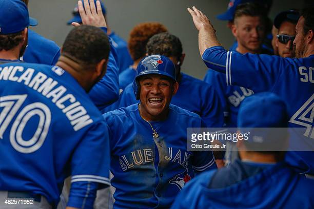 Ezequiel Carrera of the Toronto Blue Jays is congratulated by teammates after hitting a solo home run against the Seattle Mariners in the seventh...
