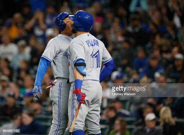 Ezequiel Carrera of the Toronto Blue Jays left chest bumps Kevin Pillar of the Toronto Blue Jays after hitting a home run against the Seattle...