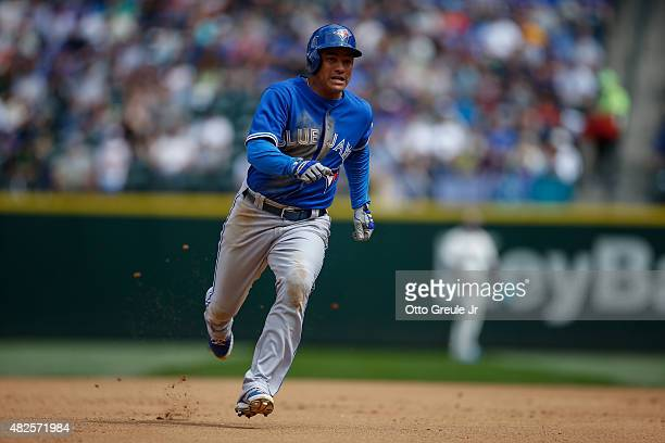 Ezequiel Carrera of the Toronto Blue Jays rounds the bases against the Seattle Mariners at Safeco Field on July 26 2015 in Seattle Washington