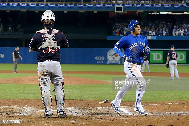 Ezequiel Carrera of the Toronto Blue Jays scores a run off of a sacrifice fly to right field hit by Kevin Pillar in the eighth inning against Mike...