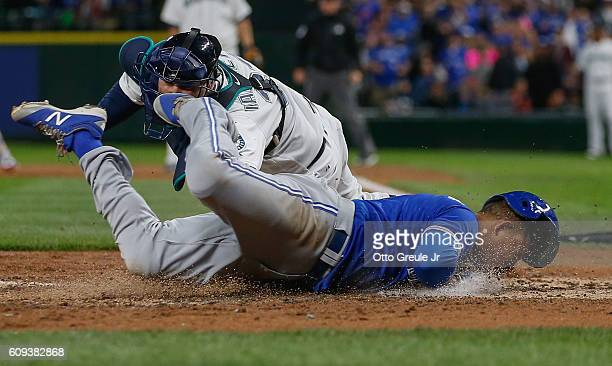 Ezequiel Carrera of the Toronto Blue Jays scores against catcher Chris Iannetta of the Seattle Mariners in the fourth inning at Safeco Field on...
