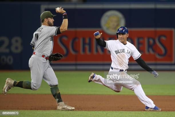 Ezequiel Carrera of the Toronto Blue Jays was awarded third base after being interfered with on this play during a rundown in the fifth inning with...