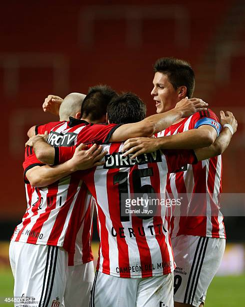 Ezequiel Cerutti of Estudiantes celebrates with teammates after forcing an own goal by Cristian Lema of Belgrano during a match between Estudiantes...