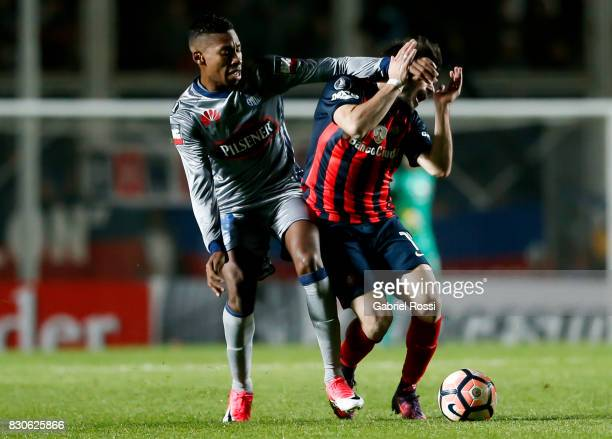 Ezequiel Cerutti of San Lorenzo fights for the ball with Eduar Preciado of Emelec during a second leg match between San Lorenzo and Emelec as part of...