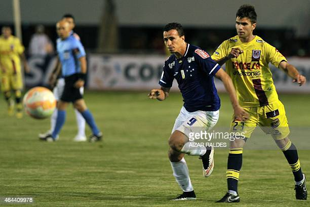 Ezequiel Filippeto of Bolivia's Universitario de Sucre vies for the ball with Leandro Damiao of Brazil's Cruzeiro during their Libertadores Cup...