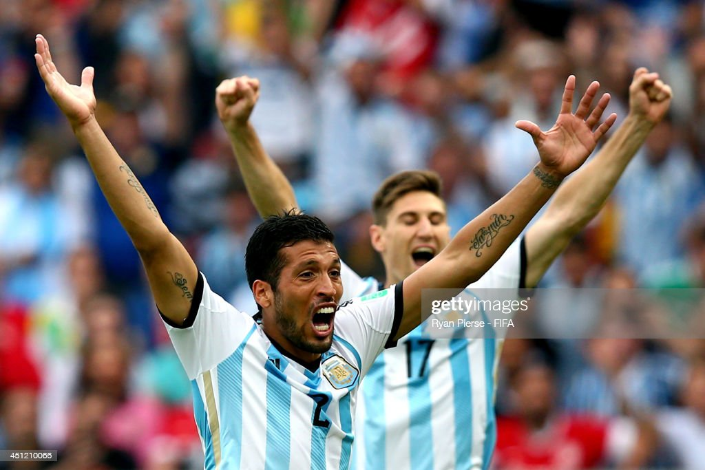 <a gi-track='captionPersonalityLinkClicked' href=/galleries/search?phrase=Ezequiel+Garay&family=editorial&specificpeople=857797 ng-click='$event.stopPropagation()'>Ezequiel Garay</a> (L) and Federico Fernandez of Argentina celebrate their third goal by <a gi-track='captionPersonalityLinkClicked' href=/galleries/search?phrase=Marcos+Rojo&family=editorial&specificpeople=6740047 ng-click='$event.stopPropagation()'>Marcos Rojo</a> (not pictured) during the 2014 FIFA World Cup Brazil Group F match between Nigeria and Argentina at Estadio Beira-Rio on June 25, 2014 in Porto Alegre, Brazil.