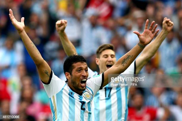 Ezequiel Garay and Federico Fernandez of Argentina celebrate their third goal by Marcos Rojo during the 2014 FIFA World Cup Brazil Group F match...