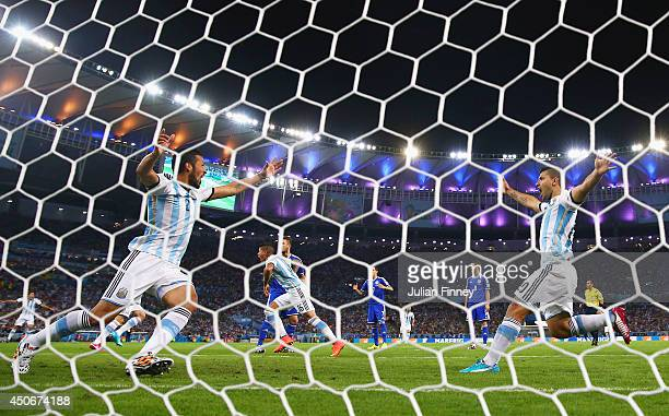 Ezequiel Garay and Sergio Aguero of Argentina celebrate their team's first goal during the 2014 FIFA World Cup Brazil Group F match between Argentina...