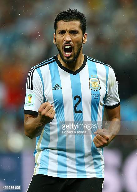 Ezequiel Garay of Argentina celebrates defeating the Netherlands in a shootout during the 2014 FIFA World Cup Brazil Semi Final match between the...