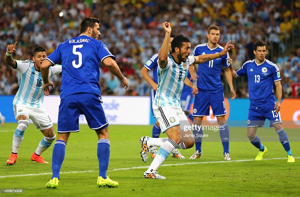 <a gi-track='captionPersonalityLinkClicked' href=/galleries/search?phrase=Ezequiel+Garay&family=editorial&specificpeople=857797 ng-click='$event.stopPropagation()'>Ezequiel Garay</a> of Argentina celebrates his team's first goal during the 2014 FIFA World Cup Brazil Group F match between Argentina and Bosnia-Herzegovina at Maracana on June 15, 2014 in Rio de Janeiro, Brazil.
