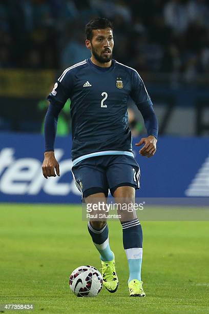 Ezequiel Garay of Argentina drives the ball during the 2015 Copa America Chile Group B match between Argentina and Uruguay at La Portada Stadium on...