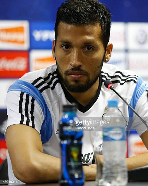 Ezequiel Garay of Argentina looks on during a press conference at Cidade do Galo Training Camp on June 12 2014 in Belo Horizonte Brazil