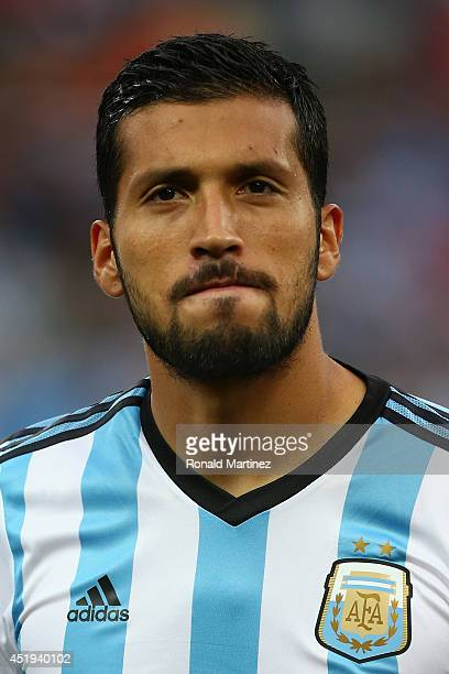 Ezequiel Garay of Argentina looks on during the National Anthem prior to the 2014 FIFA World Cup Brazil Semi Final match between the Netherlands and...