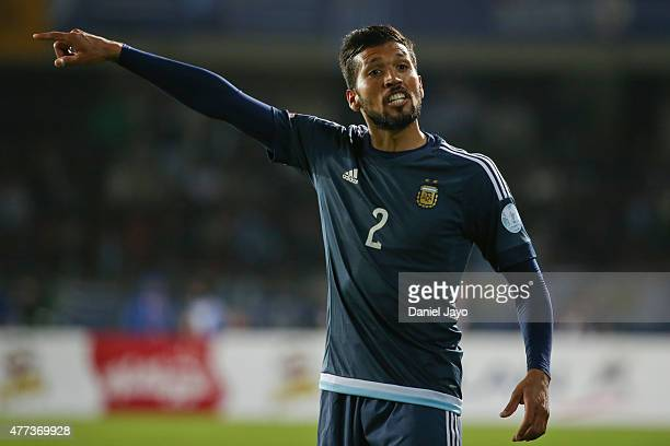Ezequiel Garay of Argentina signals during the 2015 Copa America Chile Group B match between Argentina and Uruguay at La Portada Stadium on June 16...
